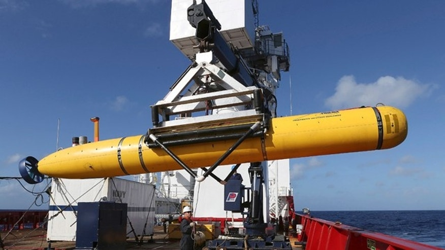 April 17, 2014: In this photo provided by the Australian Defense Force, the Phoenix International Autonomous Underwater Vehicle (AUV) Artemis is craned over the side of Australian Defense Vessel Ocean Shield before launching the vehicle into the southern Indian Ocean in the search of the missing Malaysia Airlines Flight 370.  (AP Photo/Australian Defense Force, Bradley Darvill)