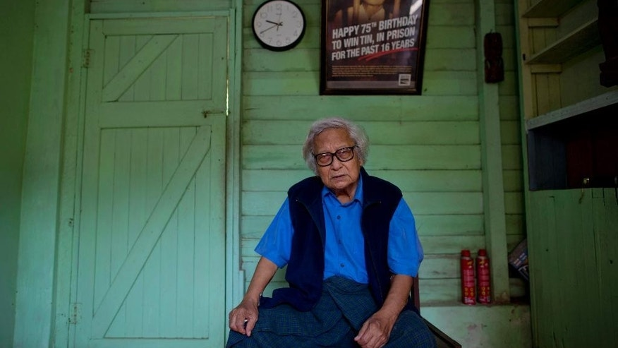 In this Oct. 24, 2013 photo, Win Tin, a former political prisoner and an opposition party stalwart poses for a picture at his home in Yangon, Myanmar. Win Tin, a prominent journalist who became Myanmar's longest-serving political prisoner after challenging military rule by co-founding the National League for Democracy has died. He was 85. He died of renal failure Monday morning, April 21, 2014, family said. (AP Photo/Gemunu Amarasinghe)