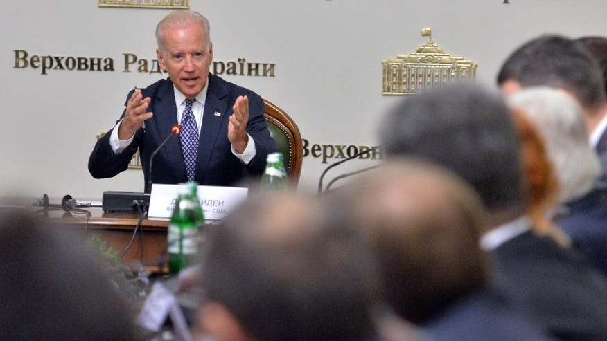U.S. Vice President Joe Biden addresses members of the Ukrainian parliament during a meeting Tuesday, April 22, 21014 in Kiev. Biden's visit to Ukraine comes at a crucial time, days after an international agreement was reached aimed at quelling violence in Ukraine. (AP Photo/Sergei Supinsky, Pool)