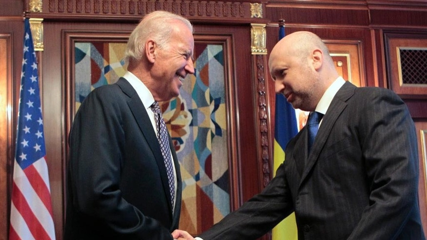 "U.S. Vice President Joe Biden, left, shakes hands with acting Ukrainian President Oleksandr Turchynov in Kiev, Ukraine, Tuesday, April. 22, 2014.  Vice President Joe Biden told Ukrainian political leaders Tuesday that the United States stands with them against ""humiliating threats"" and encouraged them to root out corruption as they rebuild their government. In the most high-level visit of a U.S. official since crisis erupted in Ukraine, Biden told leaders from various political parties that he brings a message of support from President Barack Obama as they face a historic opportunity to usher in reforms. (AP Photo/Sergei Chuzavkov, Pool)"