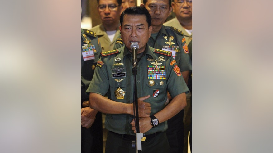 April 23, 2014: Wearing what he said to be a Chinese-made watch, Indonesian Armed Forces Chief Gen. Moeldoko speaks to the media during a press conference in Jakarta, Indonesia.
