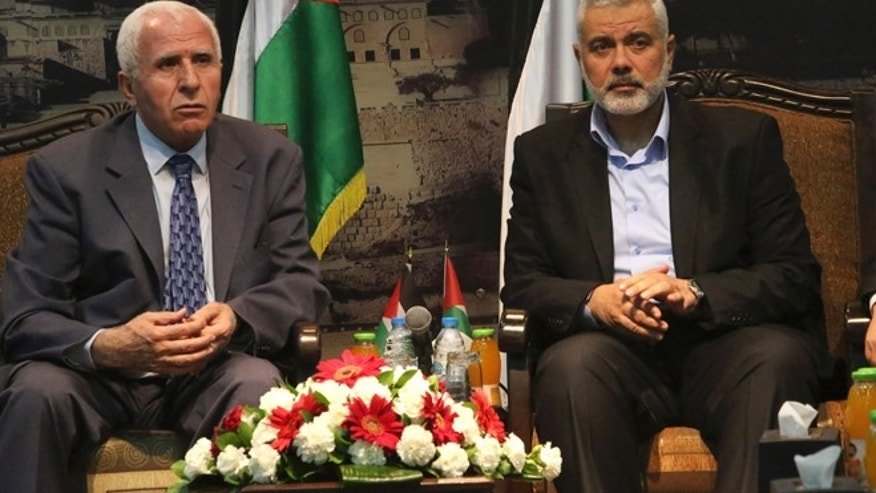 April 22, 2014: Gaza's Hamas Prime Minister Ismail Haniyeh, right, and senior Fatah official Azzam al-Ahmad meet in Gaza for talks aimed at reaching a reconciliation agreement between the two rival Palestinian groups, Hamas and Fatah.