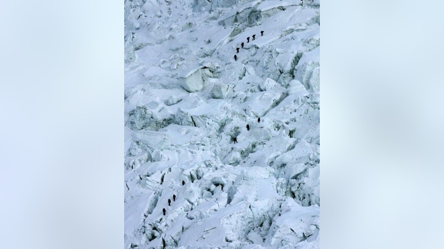 May 18, 2003: In this file photo, mountaineers pass through the treacherous Khumbu Icefall on their way to Mount Everest near Everest Base camp, Nepal.