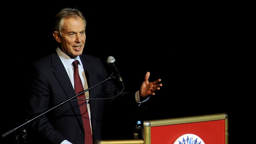 "Former British Prime Minister Tony Blair speaks at the Balkan Peace Festival, organized by the Indian ""Sahara Group"" in honor of the International Day of Non-Violence, in Skopje, Macedonia, Wednesday, Oct. 2, 2013. (AP Photo/Boris Grdanoski)"