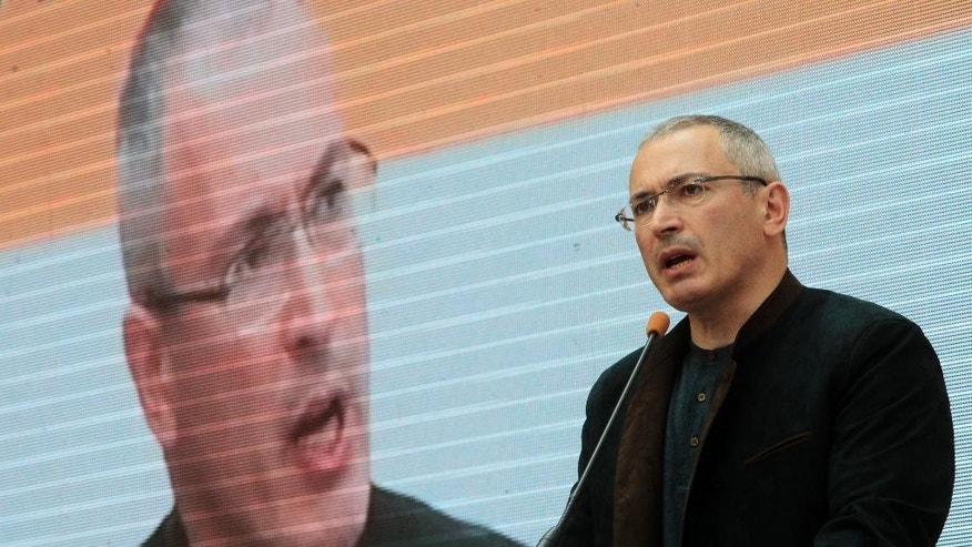 Russian former oil tycoon Mikhail Khodorkovsky speaks at a conference called Ukraine-Russia Dialogue in Kiev, Ukraine, Thursday, April 24, 2014. Russia's most famous prisoner, the former oil tycoon Mikhail Khodorkovsky, has harshly criticized Russian president Vladimir Putin, saying he was pressuring Ukraine out of petty vengeance. Khodorkovsky, who spent 10 years in prison, spoke at the opening of a conference in Kiev devoted to fostering ties between Ukraine and Russia, despite Russia's annexation of Crimea.(AP Photo/Sergei Chuzavkov)