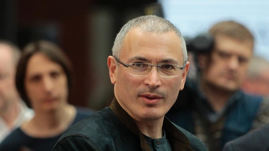 Russian former oil tycoon Mikhail Khodorkovsky attends a conference called Ukraine-Russia Dialogue,  in Kiev, Ukraine, Thursday, April 24, 2014. Russia's most famous prisoner, the former oil tycoon Mikhail Khodorkovsky, has harshly criticized Russian president Vladimir Putin, saying he was pressuring Ukraine out of petty vengeance. Khodorkovsky, who spent 10 years in prison, spoke at the opening of a conference in Kiev devoted to fostering ties between Ukraine and Russia, despite Russia's annexation of Crimea.(AP Photo/Sergei Chuzavkov)