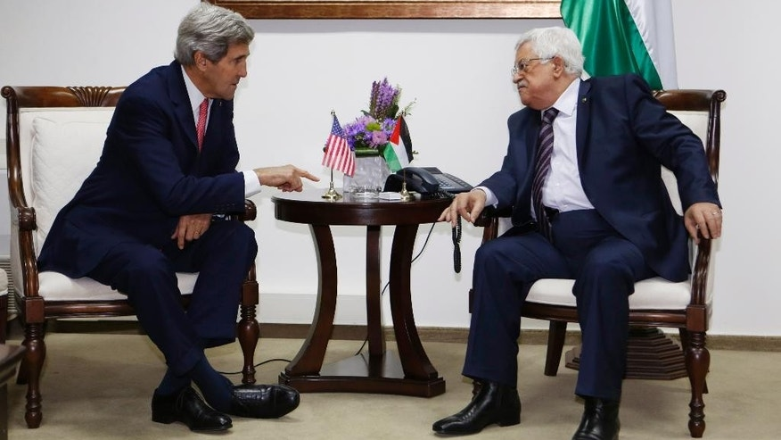 FILE - In this Dec. 5, 2013 file photo, U.S. Secretary of State John Kerry, left, meets Palestinian President Mahmoud Abbas in the West Bank city of Ramallah. Nine months of U.S.-driven diplomacy have left Israelis and Palestinians less hopeful than ever about a comprehensive peace agreement to end their century of conflict. Although a formula may yet be found to somehow prolong the talks past an end-of-April deadline, they are on the brink of collapse and the search is already on for new ideas. (AP Photo/Mohamad Torokman, Pool, File)