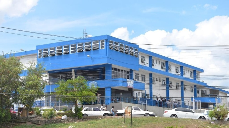 This April 17, 2014, photo, shows the main police station in the central Jamaican city of May Pen. An investigative commission tasked with probing abuse allegations against Jamaica's security forces raided the troubled police station earlier this year, seizing guns and questioning officers. So far, eight officers in the division have been charged with murder and nine more slayings are being investigated as suspicious. Jamaica's security forces have long been accused of indiscriminate shootings and unlawful killings. All total, 27 police officers are now facing charges of murder brought by the investigative commission. (AP Photo/David McFadden)
