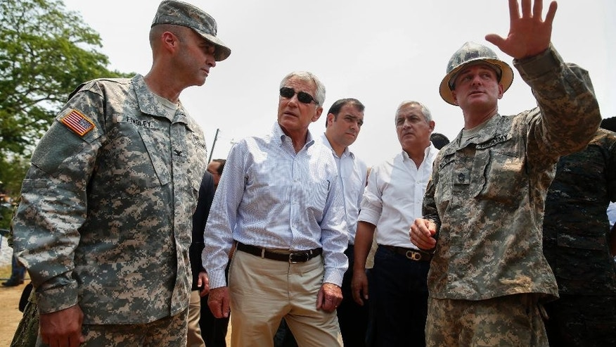 Defense Secretary Chuck Hagel and Guatemalan President Otto Perez Molina visit a U.S and Guatemalan school building base in Los Limones, Guatemala, Friday, April 25, 2014.    (AP Photo/Shannon Stapleton, Pool)
