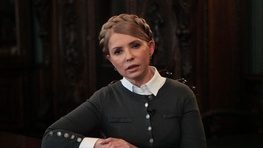"Former Ukrainian Prime Minister and candidate for the upcoming presidential elections Yulia Tymoshenko speaks during an interview with The Associated Press in Kiev, Ukraine, Saturday, April 26, 2014. Tymoshenko says Ukraine ""must be a member of NATO"" in order to protect itself from Russian aggression. While Tymoshenko has not previously backed NATO membership publicly, she and other Ukrainian politicians have ramped up the tough rhetoric as pro-Russia militias seized police stations and government buildings across eastern Ukraine. (AP Photo/Sergei Chuzavkov)"