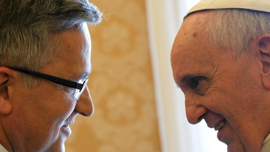 Polish President Bronislaw Komorowski, left, and Pope Francis look at each other on the occasion of their private audience at the Vatican, Saturday, April 26, 2014. Komorowski is in Rome to attend Sunday's canonization ceremony for John Paul II and John XXIII where Pope Francis will elevate the two popes to sainthood.(AP Photo/Vincenzo Pinto, Pool)