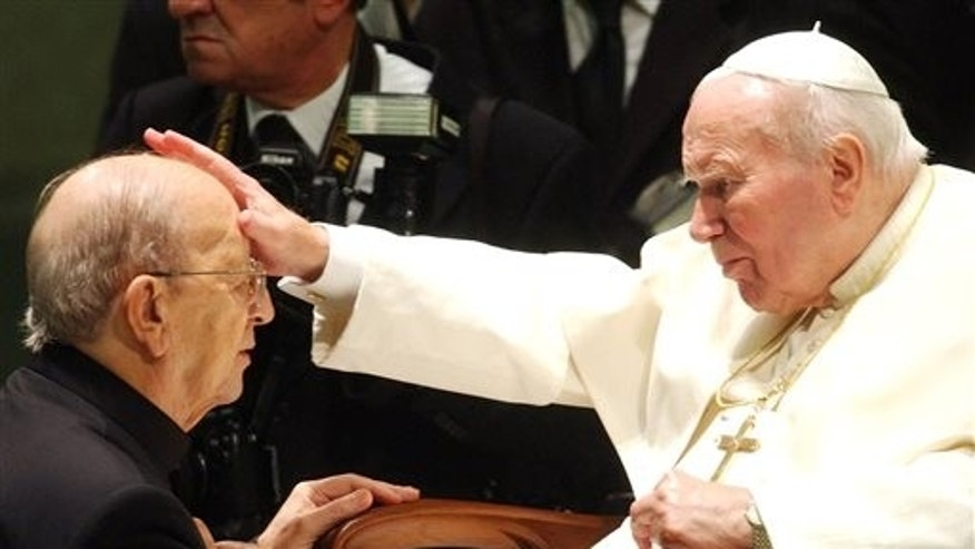 FILE - In this Nov. 30, 2004, file photo, Pope John Paul II gives his blessing to late father Marcial Maciel, founder of Christ's Legionaries, during a special audience the pontiff granted to about 4,000 participants of the Regnum Christi movement, at the Vatican.