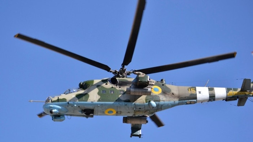 White markings on tail of helicopter are meant to distinguish Ukrainian chopper from nearly identical craft flown by Russian Army. (Ukrainian Ministry of Defense)