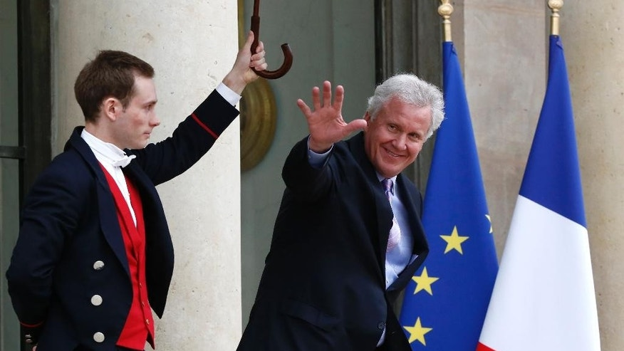 """U.S. giant General Electric Co. CEO Jeffrey R. Immelt leaves the Elysee Palace after meeting with French President Francois Hollande in Paris, Monday, April 28, 2014.  Hollande met Sunday with top members of the government to discuss Alstom, hours after the Economy Minister Arnaud Montebourg warned the engineering company not to pursue a """"precipitous"""" tie-up with U.S. giant General Electric Co., saying that France's national interest is at stake in a potential sale. (AP Photo/Michel Euler)"""