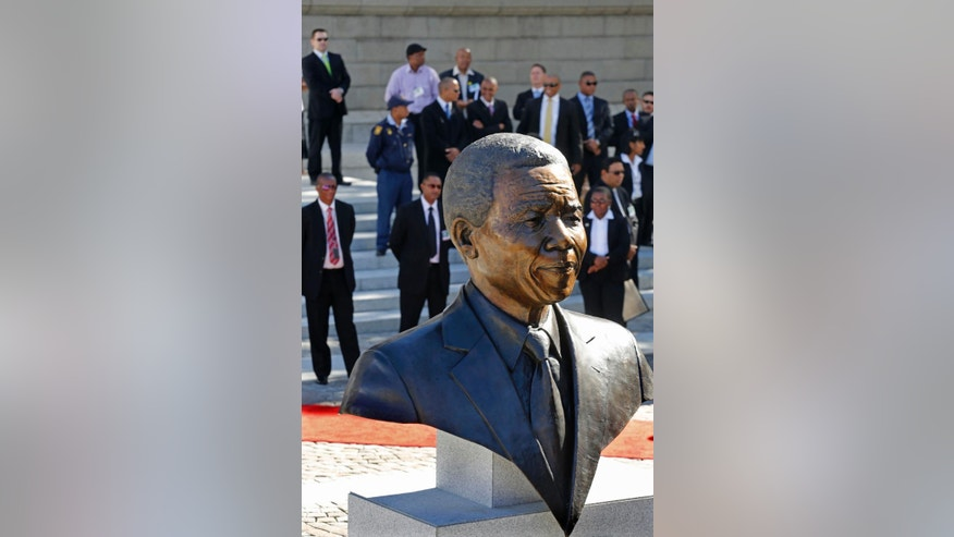 A bust of former South African President Nelson Mandela after it's unveiling by dignitaries at the South African Parliament in Cape Town, South Africa, Monday, April 28, 2014. South African President Jacob Zuma and members of the South African Parliament unveiled the bust of Mandela at Parliament, forming part of celebrations for 20-years anniversary of a democratic Parliament in South Africa after the end of white rule. (AP Photo/Schalk van Zuydam)