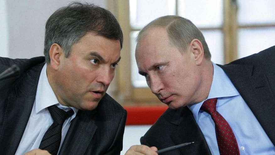 FILE - In this Monday, May 23, 2011 file photo, then, Russian Prime Minister Vladimir Putin, right, speaks with his then Chief of Staff ,Vyacheslav Volodin, during a meeting of officials in Pskov, about 600 km (375 miles) northwest of Moscow. The U.S. Department of the Treasury on Monday, April 28, 2014, designated seven Russian government officials, including two key members of the Russian leadership's inner circle, and 17 entities pursuant to Executive Order (E.O.) 13661. E.O. 13661 authorizes sanctions on, among others, officials of the Russian Government and any individual or entity that is owned or controlled by, that has acted for or on behalf of, or that has provided material or other support to, a senior Russian government official. Volodin is on the list. (AP Photo/RIA Novosti, Alexei Nikolsky, Pool, File)