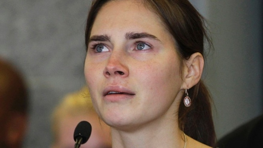 Oct. 4, 2011: In this file photo, Amanda Knox talks to reporters, in Seattle.