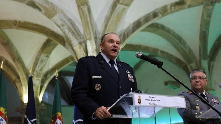 NATO's Supreme Allied Commander in Europe Philip Breedlove talks to journalist during a joint news conference with Portuguese Armed Forces General Chief Artur Pina Monteiro, right, at Sao Juliao de Barra fort in Oeiras, near Lisbon, Tuesday, April 29, 2014. During the conference, Breedlove talked about the current crisis situation in Ukraine among other issues. (AP Photo/Francisco Seco)
