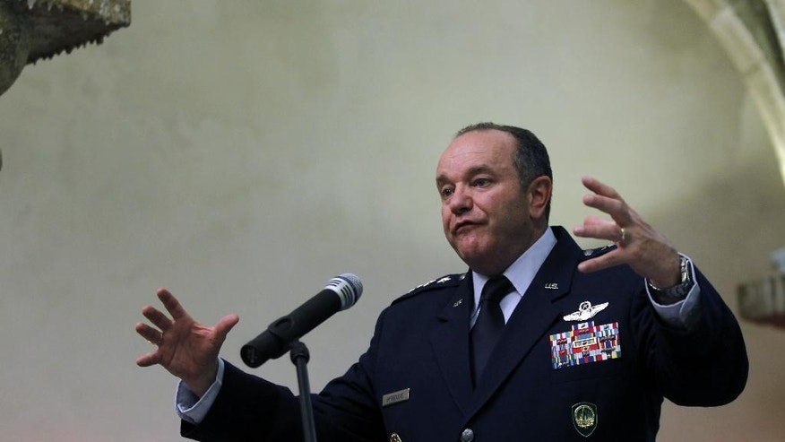 NATO's Supreme Allied Commander in Europe Philip Breedlove gestures as he answers a question during a news conference at Sao Juliao de Barra fort in Oeiras, near Lisbon, Portugal, Tuesday, April 29, 2014. During the conference, Breedlove talked about the current crisis situation in Ukraine among other issues. (AP Photo/Francisco Seco)