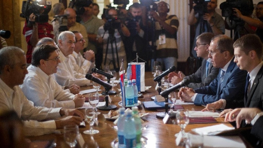Russian's Foreign Minister Sergey Lavrov, second from right, listens to Cuba's Foreign Minister Bruno Rodriguez, second from left, during a meeting in Havana, Cuba, Tuesday, April 29, 2014. Lavrov is beginning his tour of Latin America in Cuba. (AP Photo/Ramon Espinosa)