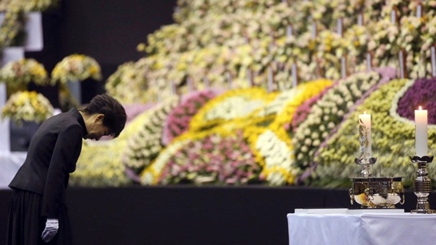 April 29, 2014: South Korean President Park Geun-hye pays tribute to the victims of the sunken ferry Sewol at a group memorial altar in Ansan, south of Seoul. (AP Photo/Yonhap)