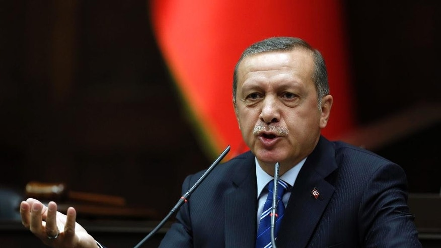 April 29, 2014: Turkish Prime Minister Recep Tayyip Erdogan addresses his supporters at the parliament in Ankara, Turkey.