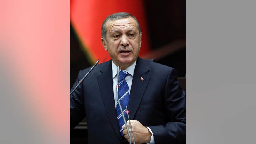 Turkish Prime Minister Recep Tayyip Erdogan addresses his supporters at the parliament in Ankara, Turkey, Tuesday, April 29, 2014. Erdogan said Turkey will ask the United States to extradite Turkish Islamic spiritual leader Fethullah Gulen. Erdogan has accused Gulen of orchestrating an alleged plot aimed to undermine and bring down his government. (AP Photo)