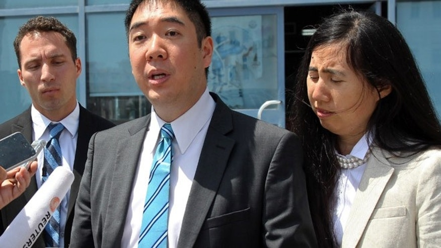 March 27, 2014: In this file photo, Matthew, left, and Grace Huang, an American couple charged with starving to death their 8-year-old adopted daughter, speak to the press outside a courthouse before their trial in Doha, Qatar.