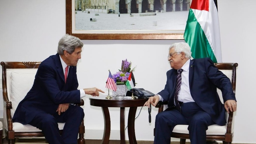 FILE - In this Dec. 5, 2013 file photo, U.S. Secretary of State John Kerry, left, meets Palestinian President Mahmoud Abbas in the West Bank city of Ramallah. Tuesday, April 29, 2014, was to have been the day to seal a deal on a Palestinian state alongside Israel. Instead, it became another missed deadline in two decades of negotiating failures. The gaps between Israeli and Palestinian positions remain vast after nine months of talks launched by Secretary of State John Kerry. He hasn't given up, but there's a sense the U.S. may have to change its traditional approach to brokering talks. Israeli Prime Minister Benjamin Netanyahu and Palestinian President Mahmoud Abbas now face risky paths that could lead to a new conflagration. Here's a look at what might happen next. (AP Photo/Mohamad Torokman, Pool, File)