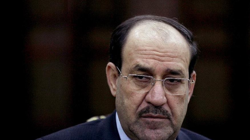 FILE  - In this, Feb. 27, 2013, file photo Iraq's Prime Minister Nouri al-Maliki listens to a question during an interview with The Associated Press in Baghdad, Iraq. If Iraqi Prime Minister Nouri al-Maliki wins a third four-year term in parliamentary elections Wednesday, he is likely to rely on a narrow sectarian Shiite base, only fueling divisions as Iraq slides deeper into bloody Shiite-Sunni hatreds. (AP Photo/Khalid Mohammed, File)