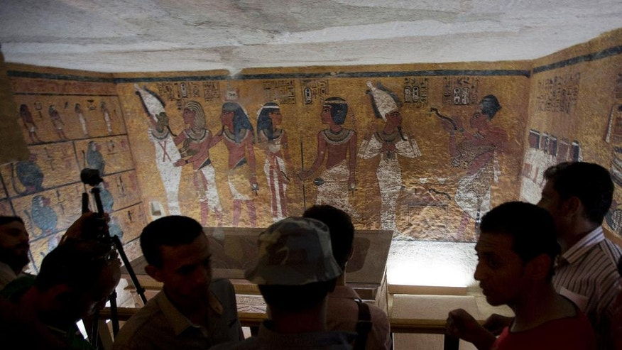 Foreign diplomats and Egyptologists attend the opening of an exact replica of the Tomb of Tutkankhamun in Luxor , Egypt. Wednesday, April 30, 2014. The replica aims to help preserve the original, more than 3,300-year-old tomb from deterioration caused by tourist visitors. (AP  Photo/Khalil Hamra)