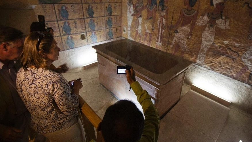 Foreign diplomats and Egyptologists attend the opening of an exact replica of the Tomb of Tutkankhamun in Luxor , Egypt, Wednesday, April 30, 2014. The replica aims to help preserve the original, more than 3,300-year-old tomb from deterioration caused by tourist visitors. (AP  Photo/Khalil Hamra)
