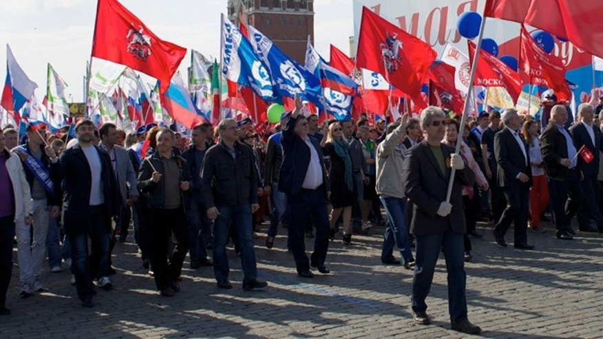 May 1, 2014: Members of Russian Trade Unions march during the May Day celebration in Red Square, Moscow, Russia. About 100,000 people have marched through Red Square to celebrate May Day, the first time the annual parade has been held on the vast cobblestoned square outside the Kremlin since the fall of the Soviet Union in 1991.