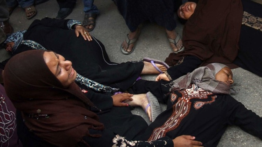 April 28, 2014: Egyptian women overcome by emotion fall to the ground after a judge sentenced to death more than 680 alleged supporters of the countrys ousted Islamist president over acts of violence and the murder of policemen in the latest mass trial in the southern city of Minya, Egypt.
