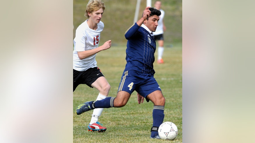 In this Oct. 8, 2013,  photo Diren Dede, right, plays in a Big Sky soccer game against Hellgate. Markus Kaarma, 29, was released from jail Monday, April 28, 2014,  after posting a $30,000 bond on a charge of deliberate homicide in the death of Diren Dede of Hamburg, Germany.  (AP Photo/The Missoulian, Tom Bauer)