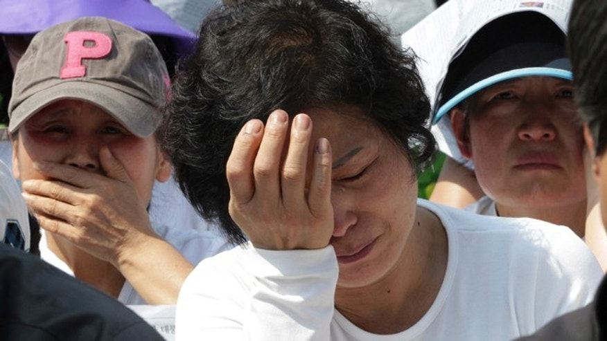 May 1, 2014: Workers weep during a May Day rally to pay tribute to the victims of the sunken ferry Sewol in Seoul, South Korea.