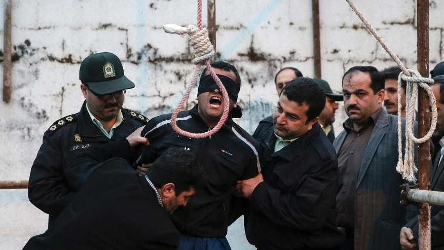 FILE - This Tuesday, April 15, 2014 file photo, provided by ISNA, a semi-official news agency, shows a blindfolded Iranian man Bilal being prepared to be hanged in public in the northern city of Nour, Iran. Bilal, who was convicted of killing Abdollah Hosseinzadeh, was pardoned by the victim's family moments before being executed. His mother, Samerah Alinejad tells The Associated Press that she had felt she could never live with herself if the man who killed her son were spared. But in the last moment, she pardoned him in an act that has made her a hero in her hometown, where banners in the streets praise her family's mercy. (AP Photo/ISNA, Arash Khamoushi, File)