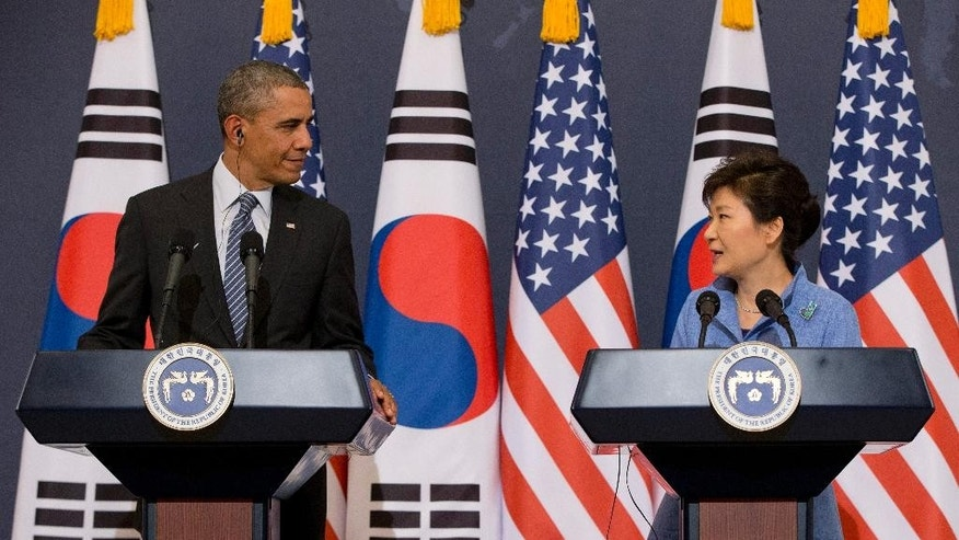 "FILE - In this April 25, 2014 file photo, U.S. President Barack Obama, left, and South Korean President Park Geun-hye participate in a joint news conference at the Blue House, in Seoul, South Korea.  While in Seoul last week, Obama said threats by North Korea will get it ""nothing except further isolation"" from the global community. But Obama acknowledged there are limits to what impacts additional penalties can have on the country. (AP Photo/Carolyn Kaster, File)"