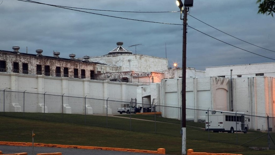 This April 29, 2014 photo shows the Oklahoma State Penitentiary in McAlester, Okla. after Robert Patton stopped the execution of Clayton Lockett. Lockett died 43 minutes after his execution began Tuesday night as Oklahoma used a new drug combination for the first time in the state. Autopsy results are pending but state prison officials say Lockett apparently suffered a massive heart attack. (AP Photo/Tulsa World, John Clanton)  KOTV OUT; KJRH OUT; KTUL OUT; KOKI OUT; KQCW OUT; KDOR OUT; TULSA OUT; TULSA ONLINE OUT