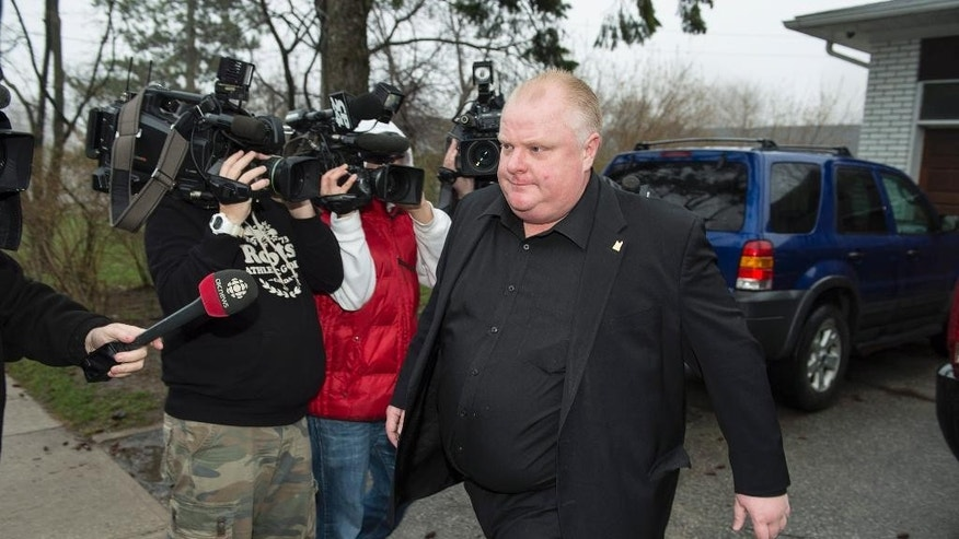 Toronto Mayor Rob Ford leaves his home early Thursday May 1, 2014, in Toronto. Ford will take an immediate leave of absence to seek help for alcohol, he said, as a report surfaced about a second video of the mayor smoking what appears to be crack cocaine. (AP Photo/The Canadian Press, Frank Gunn)