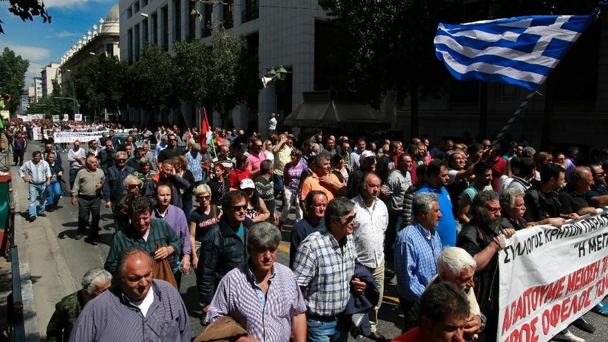 Greek farmers market vendors march during a protest in Athens, Friday, May 2, 2014, after their trading association launched an indefinite strike Monday. The market vendors are the latest professional group in Greece to protest a sweeping liberalization drive demanded by rescue creditors. (AP Photo/Dimitri Messinis)