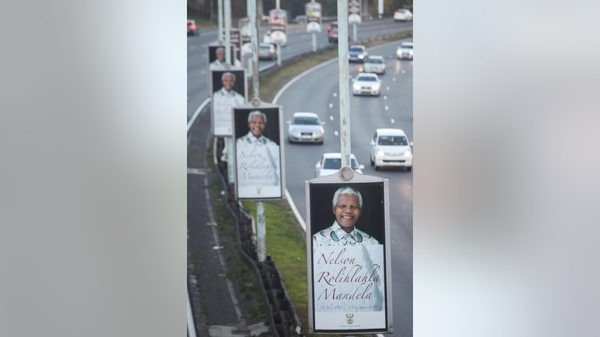 Posters depicting the late former president Nelson Mandela are lined up along a freeway in Johannesburg, Friday May 2, 2014. The country goes to the polls Wednesday May 7 as South Africa marks its 20th anniversary of democracy on Sunday. Mandela, the anti-apartheid leader became president in 1994 and died in December at the age of 95. (AP Photo/Denis Farrell)