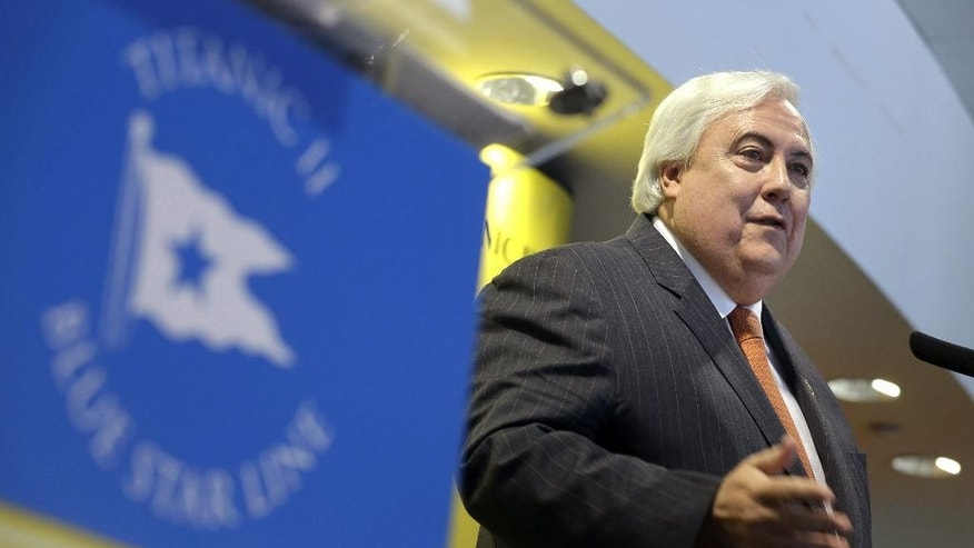 In this Feb. 26, 2013 file photo, Australian billionaire Clive Palmer speaks during a news conference in New York, about his intention to build the Titanic II. Palmer is a larger-than-life Australian multimillionaire whose headline-grabbing projects include building a replica of the Titanic and a Jurassic Park-style collection of 160 mechanized dinosaurs. (AP Photo/Seth Wenig, File)