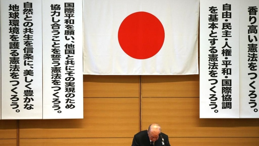 In this Thursday, May 1, 2014 photo, former Japanese Prime Minister Yasuhiro Nakasone bows after delivering a speech at a meeting of a pro-constitution amendment group in Tokyo. Japan is marking the 67th anniversary of its postwar constitution on May 3, 2014 with growing debate over whether to revise the war-renouncing document. Prime Minister Shinzo Abe's ruling conservative party has long advocated revision but been unable to sway public opinion. Now he proposes that the government reinterpret the constitution so it can loosen the reins on its military without having to win approval for constitutional change. (AP Photo/Eugene Hoshiko)