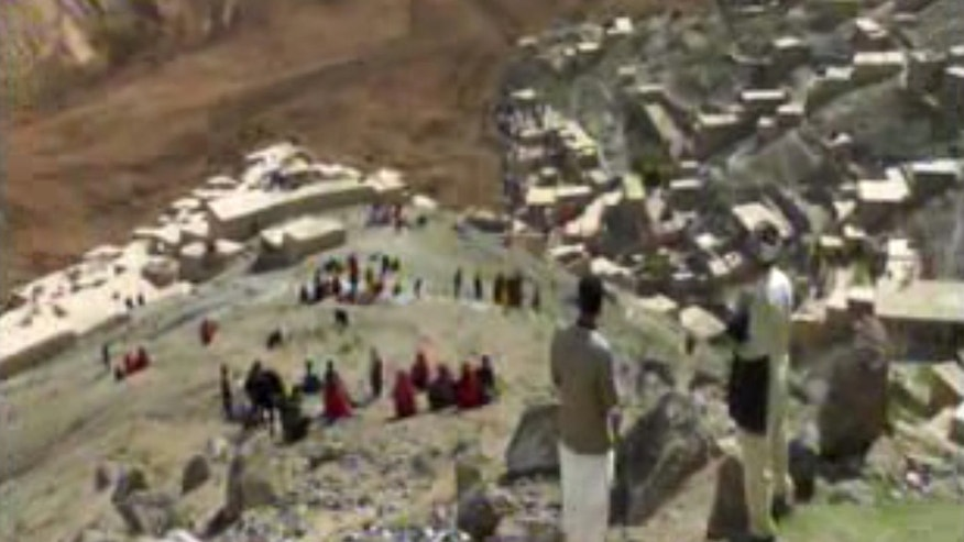 May 2, 2014 - Image (made from AP video) shows people searching for survivors after a massive landslide buried a village in Badakhshan province, northeastern Afghanistan, which Afghan and U.N. officials say left hundreds dead and hundreds more missing.