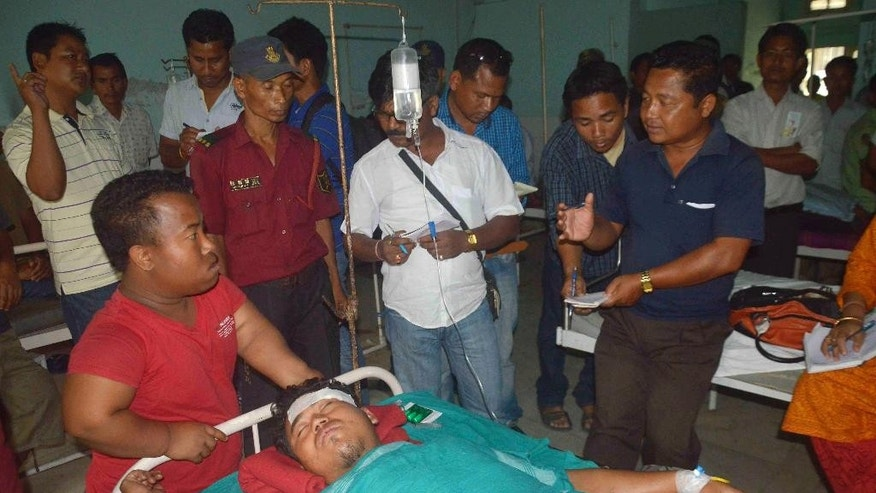A man injured in an attack receives treatment at a civil hospital in Kokrajhar, in the northeastern Indian state of Assam, Friday, May 2, 2014. Separatist militants opened fire with automatic weapons on Muslim villagers in remote northeastern India, killing at least 10 people, including two children, in two attacks, police said Friday. Four people were wounded. (AP Photo)