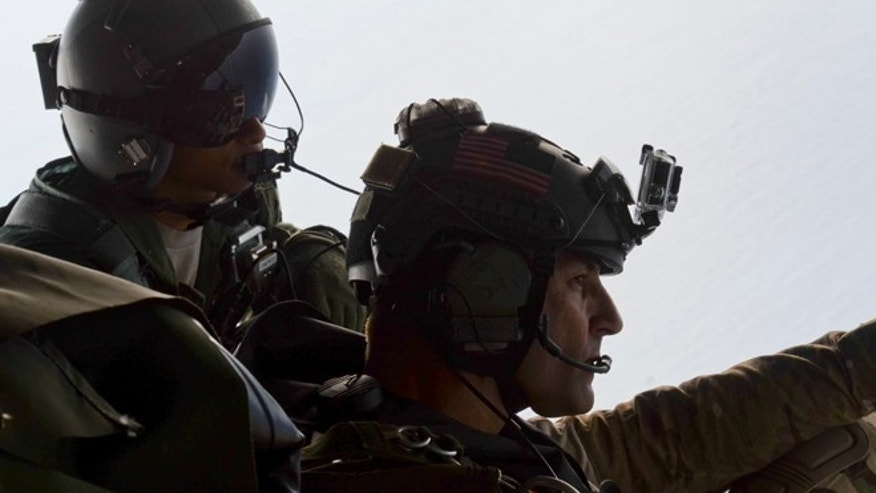 May 3, 2014: Airman 1st Class Franscisco Harper, left, and a pararescue airman survey the area as U.S. Air Force pararescue forces parachute into the Pacific Ocean to aid to two critically injured sailors aboard a Venezuelan fishing boat.
