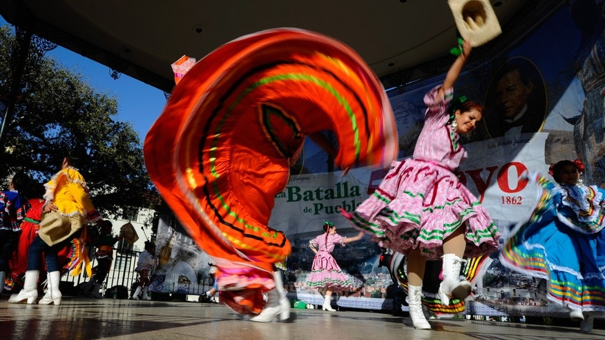 LOS ANGELES, CA - MAY 05:  members of Mexica Ballet Folclorico perform during Cinco De Mayo festivities on May 5, 2011 at El Pueblo de Los Angeles Historic Site on Olvera Street in downtown Los Angeles, California. Cinco de Mayo celebrates the 1862 Mexican victory over the French in the Battle of Puebla.  (Photo by Kevork Djansezian/Getty Images)