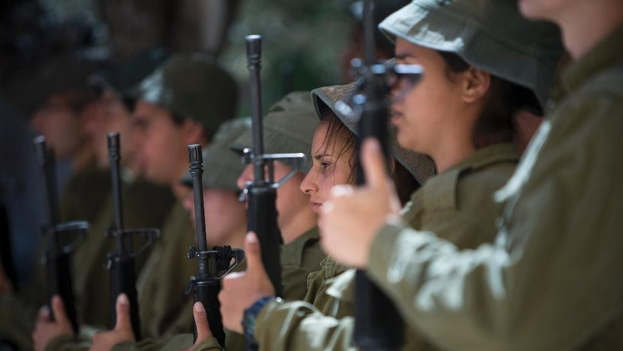 Israeli soldier honor guard conduct a rehearsal for the Memorial Day ceremony at Kiryat Shaul Military cemetery in Tel Aviv, Israel, Sunday, May 4, 2014. Israel will mark the annual Memorial Day in remembrance of soldiers who died in the nation's conflicts, beginning at dusk Sunday until Monday evening. (AP Photo/Oded Balilty)