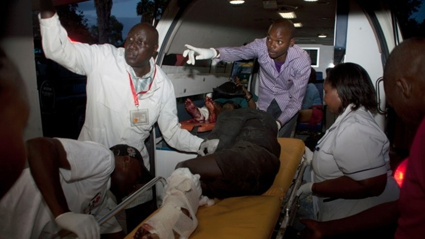 May 4, 2014: An injured person is carried from an ambulance at Kenyatta National Hospital, Nairobi.